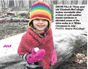 ?? PHOTO: Matine McCullagh ?? JULY SNOW FALLS: Three year old Elizabeth McCullagh makes snowballs after a blast of cold weather meant residents in elevated areas of the shire woke to a 'White Christmas in July'.