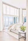 ??  ?? Motorized window treatments are a good way to cover walls of high windows.