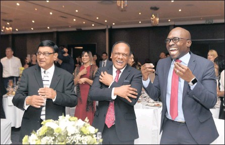 ?? PICTURE: ITUMELENG ENGLISH / ANA ?? GOOD CAUSE: Amit Ramasar, left, businessman Vivian Reddy and Finance Minister Malusi Gigaba share a laugh at the Child Welfare South Africa dinner in Sandton on Friday, when R210 000 in open pledges was received.