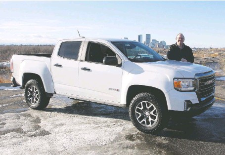 ?? PHOTOS: BRENDAN MILLER ?? Trevor Lynn with the 2021 GMC Canyon AT4 on the outskirts of Calgary.