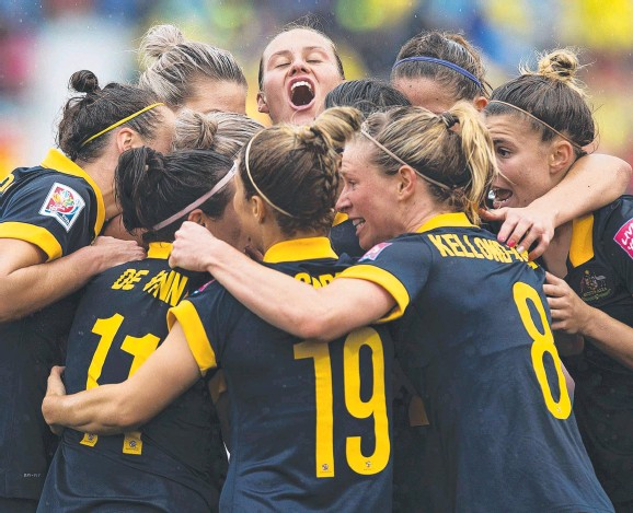 ?? Picture: ANDREW VAUGHAN/THE CANADIAN PRESS/AP ?? SHOT AT THE TITLE: Australian players celebrate after Kyah Simon scored the winner against Brazil.