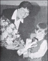 ??  ?? In 1996: Argyll and Bute MP Ray Michie receiving flowers from young Andrew McCallum at the official opening of the newly-refurbished Carradale Village Hall.