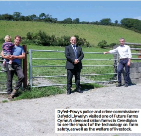 ??  ?? Dyfed-powys police and crime commissioner Dafydd Llywelyn visited one of Future Farms Cymru's demonstration farms in Ceredigion to see the impact of the technology on farm safety, as well as the welfare of livestock.
