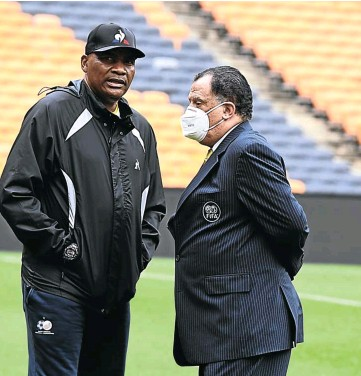 ?? Picture: Gallo Images ?? CENTRE OF THE STORM Molefi Ntseki, sacked this week, with Safa president Danny Jordaan at a Bafana training session last month.
