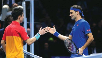 e6d6f559 Japan's Kei Nishikori shakes hands with Switzerland's Roger Federer after  their match at the ATP Finals Photo: AP