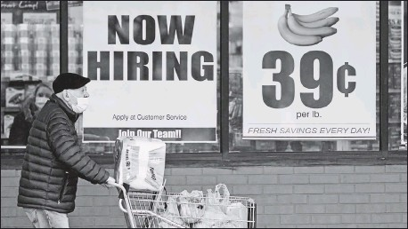 ?? THE ASSOCIATED PRESS ?? A grocery store in Mayfield Heights, Ohio, advertised jobs in January. Employers added just 266,000 jobs in April, sharply lower than in March.
