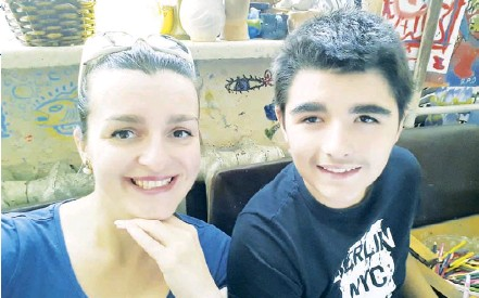 ??  ?? Ukrainian Olha Kudryk poses for a photograph together with her son Yaroslav. Kudryk's son was kidnapped by her ex-husband in 2020.