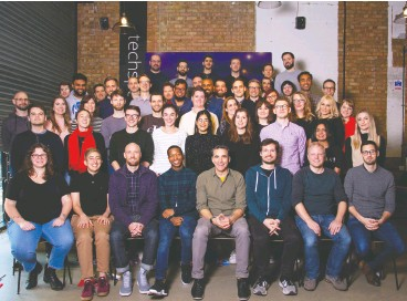 ?? Trint ?? Reporter-turned-tech CEO Jeff Kofman, seated in the middle of the front row, with members of the Trint team in December 2019.