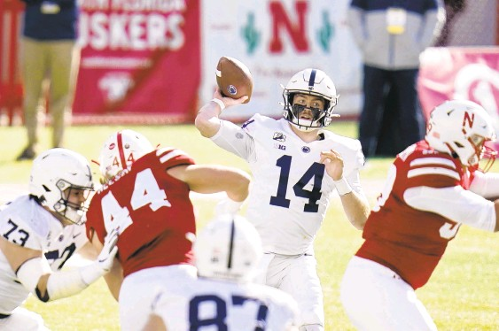 ?? NATI HARNIK/AP ?? Penn State quarterbac­k Sean Clifford (14) throws during the first half against Nebraska on Saturday in Lincoln, Neb.