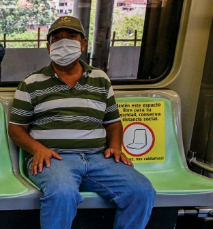 """??  ?? SIGNS OF THE TIMES (above): Masked and in designated seats, metro car passengers in Medellin, Colombia, await departure in early May. The COVID-19 """"virus vernacular"""" has been growing since January, and the medical meaning of """"face mask"""" has clearly overtaken its use as a scuba essential or beauty treatment. Lexicographers have noted that the words in constructions such as """"social distancing"""" and """"selfisolation"""" aren't new: they're just being used in new ways."""