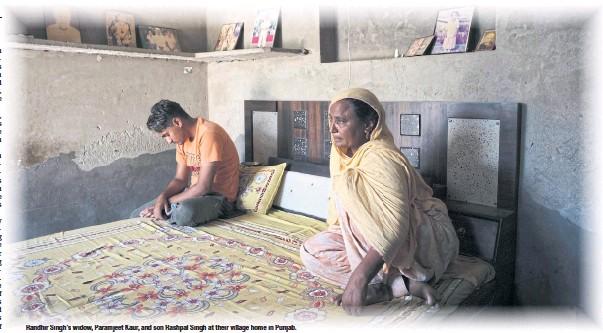 ??  ?? Randhir Singh's widow, Paramjeet Kaur, and son Rashpal Singh at their village homeinPunjab.