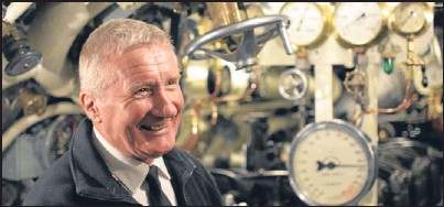 ?? Picture: PA. ?? Former submariner and volunteer guide John Buffery on board submarine HMS Alliance.