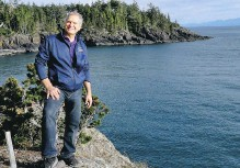 ?? CLAIRE YOUNG ?? Michael Thornton, developer of SookePoint Cottage Resort, enjoys the view from the high craggy point it's being built on.