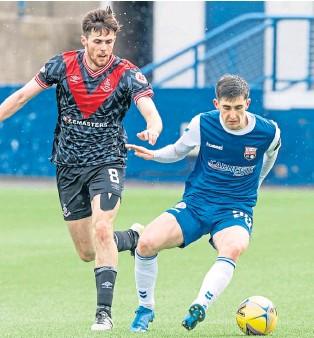 ??  ?? Chris Mochrie (Montrose) keeps the ball away from Airdrieonians defender Paul Mckay at Links Park