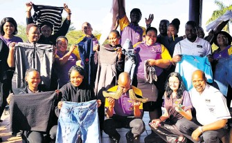 ??  ?? The Hollywood Bets team in Empangeni joined the Mandela Day drive by hanging a line outside its premises, encouraging staff and patrons to donate clothing for the less privileged