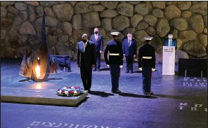 ??  ?? U.S. Defense Secretary Lloyd Austin (left) attends a service Monday at the Hall of Remembrance in the Yad Vashem Holocaust Museum in Jerusalem. Austin began his trip Sunday in Israel. (AP/Robert Burns)