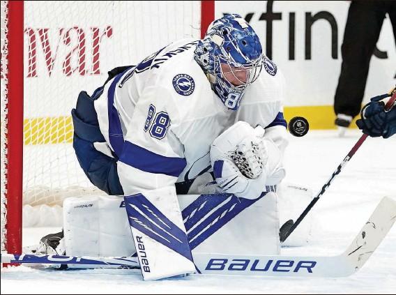 ?? MARK HUMPHREY | Associated Press ?? Lightning goaltender Andrei Vasilevskiy blocks a shot on his way to making 36 saves against the Predators on Saturday night for his fourth shutout of the season.
