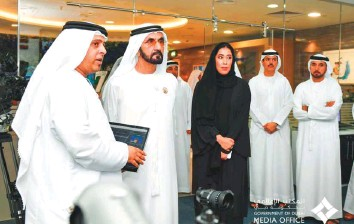 ?? Courtesy: Dubai Media Office ?? Shaikh Mohammad being briefed about the Media Briefings Programme in the presence of Mona Al Merri during a visit to the Government of Dubai Media Office headquarters yesterday.