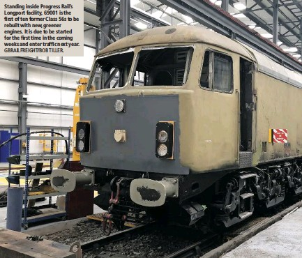 ?? GBRAILFREI­GHT/BOB TILLER. ?? Stand­ing in­side Progress Rail's Long­port fa­cil­ity, 69001 is the first of ten for­mer Class 56s to be re­built with new, greener en­gines. It is due to be started for the first time in the com­ing weeks and en­ter traf­fic next year.