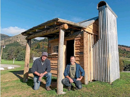 ?? HELEN NICKISSON/STUFF ?? A replica miner's hut has recently been completed at Canvastown. Les Douglas, left, and Craig Dobie have worked on the construction. The hut will serve as a tourist information centre for the town.