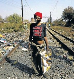 ?? Picture: Alon Skuy ?? A waste picker in Kliptown, Soweto. Hunger, poverty and a lack of dignity will be eased somewhat by a realistic basic income grant for people aged 18 to 59, says the writer.
