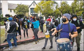 ?? Brian van der Brug Los Angeles Times ?? DEMONSTRATORS march Dec. 7 outside the residence of Mayor Eric Garcetti, to protest his expected nomination to a Cabinet post in the Biden administration.