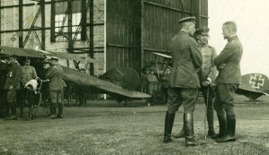 ??  ?? ■ Taken at Gontrode, East Flanders, in the first week of July 1917, this photograph shows Richthofen in conversation with Hauptmann Rudolf Kleine and Oberleutnant Martin Gerlich of Kampfgeschwader 3. The two Albatros D.V are parked in the background. The front one, seemingly painted red overall, is Richthofen's machine (1177/17).