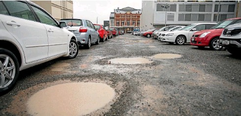 ??  ?? Saturated potholes in a Wilson Parking car park on Gloucester St.