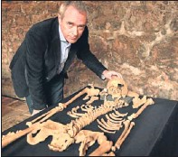 ?? Pictures: PA ?? Archaeologist Jay Carver with the remains.