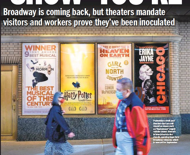 """??  ?? Pedestrians stroll past theaters that are still closed as shows such as """"Hadestown"""" (right) remain closed. Dancers in March took to the streets, spurring hope for a Broadway rebound, which is now set for September."""