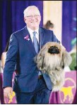 ??  ?? David Fitzpatrick holds his dog, Wasabi, a Pekingese, which won Best in Show at the Westminster Kennel Club dog show, June 13, 2021, in Tarrytown, NY. (AP)