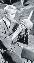 """?? Photo: Getty Images ?? TORTURED: Lawrence Olivier speaks with the skull of """"Yorick"""""""