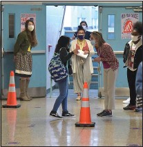 ?? PETE BANNAN - MEDIANEWS GROUP ?? Beverly Hills Middle School students make their way through halls on the second week back for in-person classes.