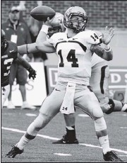 ?? 2012, JOE MAHONEY/TIMES-DISPATCH ?? Taylor Heinickewa­s a force at quarterbac­k at Old Dominion, where he threwfor 14,959 yards and 132 touchdowns and set several FCS records.