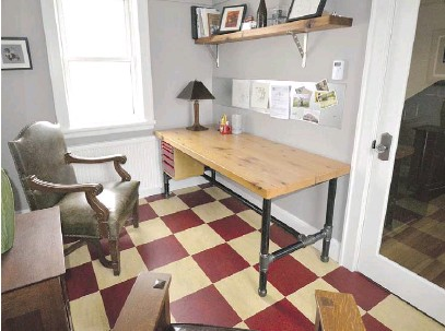 ?? RORY MCDONNELL PHOTOS ?? The kitchen is unobtrusive in the large room, but spacious and functional. The home office was once a cloakroom on the girls' side of the entry.
