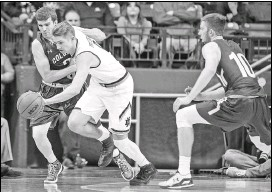 ?? ROBERT FRANKLIN / ASSOCIATED PRESS ?? Rex Pflueger of Notre Dame steals the ball between Colgate's Nathan Harris, left, and Will Rayman during the first half of Monday's game. Notre Dame won, 77-62.