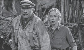 """?? PROVIDED BY FRANK MASI/ DISNEY ?? Why so serious? Frank Wolff ( Johnson) and Lily Houghton ( Blunt) encounter dangers in Disney's """"Jungle Cruise."""""""