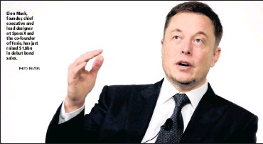 ?? PHOTO: REUTERS ?? Elon Musk, founder, chief executive and lead designer at SpaceX and the co-founder of Tesla, has just raised $1.8bn in debut bond sales.