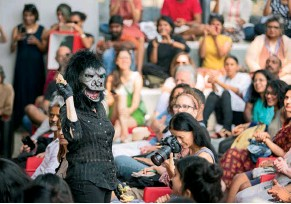 ??  ?? This page, centre: The Guerrilla Girls deliver a lecture-performance at the Biennale Pavilion They have been out in the street baring their fangs…