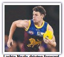 ??  ?? Lachie Neale driving forward.