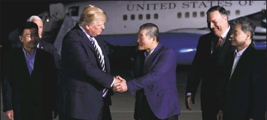 ?? Susan Walsh / Associated Press ?? President Donald Trump, center left, shakes hands with Kim Dong Chul, with Tony Kim, far left, and Kim Hak Song, far right, the three Americans who were detained in North Korea for more than a year, upon their arrival at Andrews Air Force Base in...