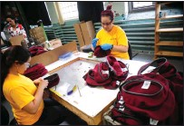 ?? Ernest A. Brown photo ?? Scarleth Sanchez, left, and Abigail Colon are busy working on berets for the Defense Department at H. Brickle and Son in Woonsocket Wednesday afternoon.