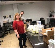 """??  ?? BJ Gutierrez, Director of HR, and Jacob Brown, General Manager, assemble COVID-19 """"Survival Kits,"""" which were gifted to METALfx employees."""
