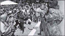 ?? BOB BROWN/TIMES-DISPATCH ?? The 2008 unveiling of the Virginia Civil RightsMemorial on Capitol Square, which features a representation of 16-year-old Barbara Johns, drewa huge crowd.