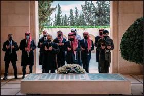?? (AP/Jordanian Royal Court) ?? Jordan's King Abdullah II (center), Prince Hamzah (second left) and other dignitaries visit the tomb of King Hussein on Sunday in Amman.