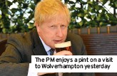 ??  ?? The PM enjoys a pint on a visit to Wolverhampton yesterday