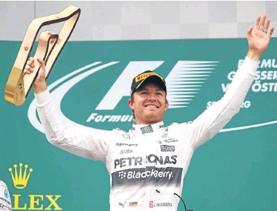 ?? Picture: Getty Images. ?? Nico Rosberg celebrates on the podium after winning to close the gap on drivers' championship leader Lewis Hamilton to 10 points.