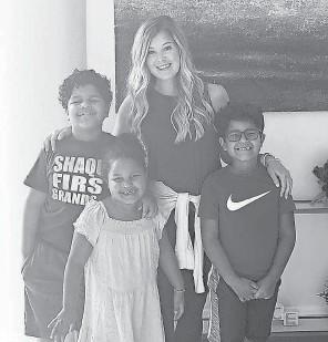 ?? PHOTO COURTESY OF JORDANNA BARRETT ?? Hannah Sandru has been home- schooling the three Barrett children this season.