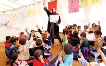 ??  ?? أ QaاH سوريون يتلقون Lعليمهم في أحد م`يماU اللجوء في الأردن