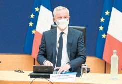 ?? ERIC PIERMONT AFP VIA GETTY IMAGES ?? Economy and Finance Minister Bruno Le Maire said France is considering easing the cost of rising energy bills for consumers. It's already handing out vouchers worth about $244 per year to nearly 5.5 million poor households.